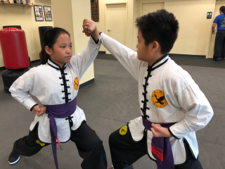 Kids Martial Arts Practice Instills Strong Commitment Skills for School & Life-Long Success
