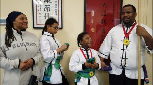Families practice martial arts together
